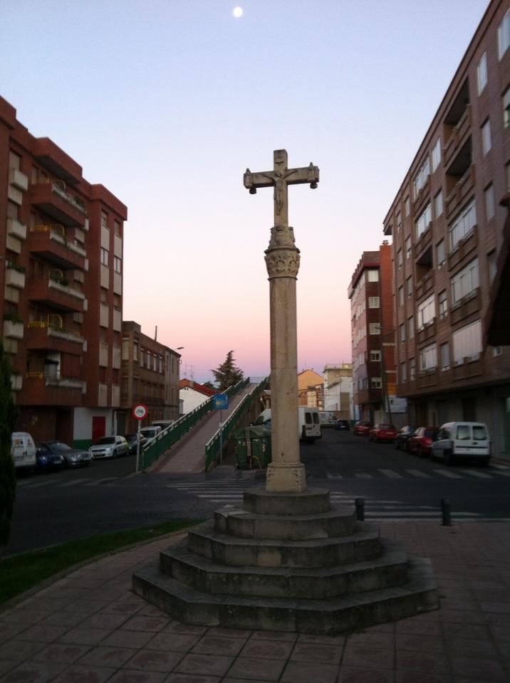 Pilgrim monument with railway overpass in background, León