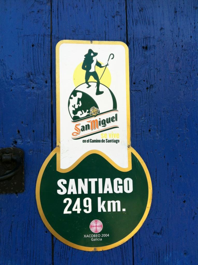 San Miguel kilometer marker at café in Murias de Rechivaldo