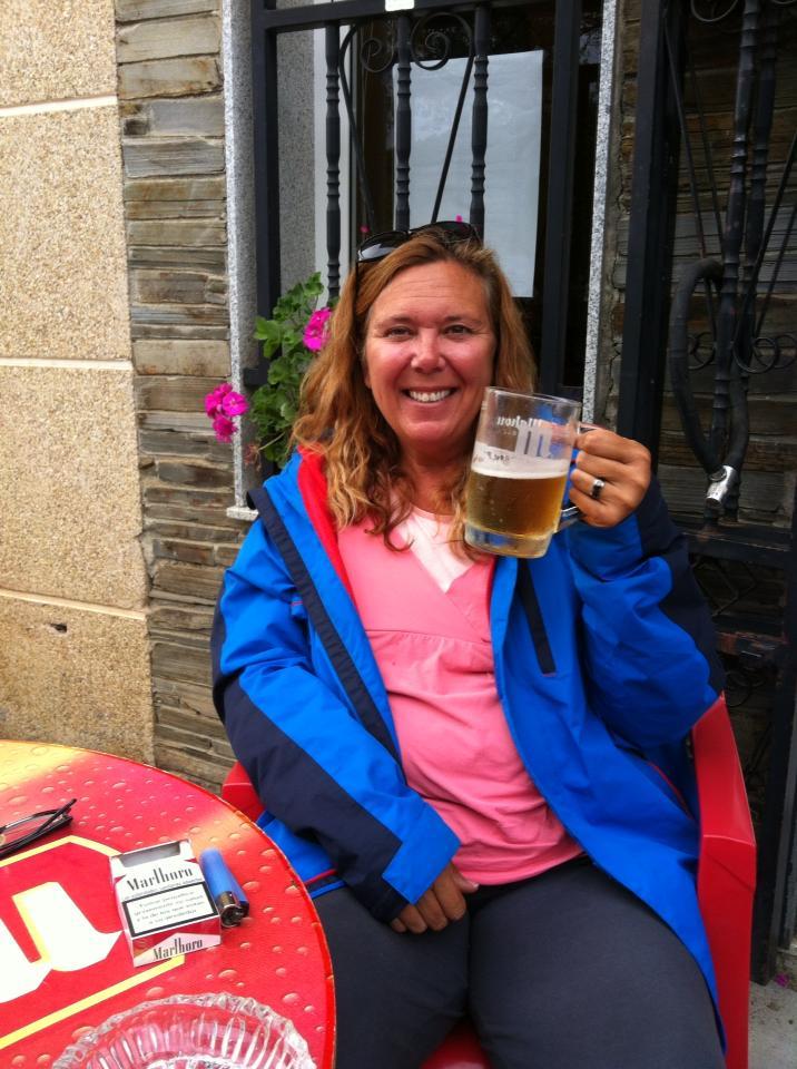 Tracy enjoying her post hike beer in Triacastela