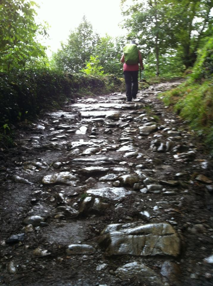 Muddy and rocky trail leading to La Faba