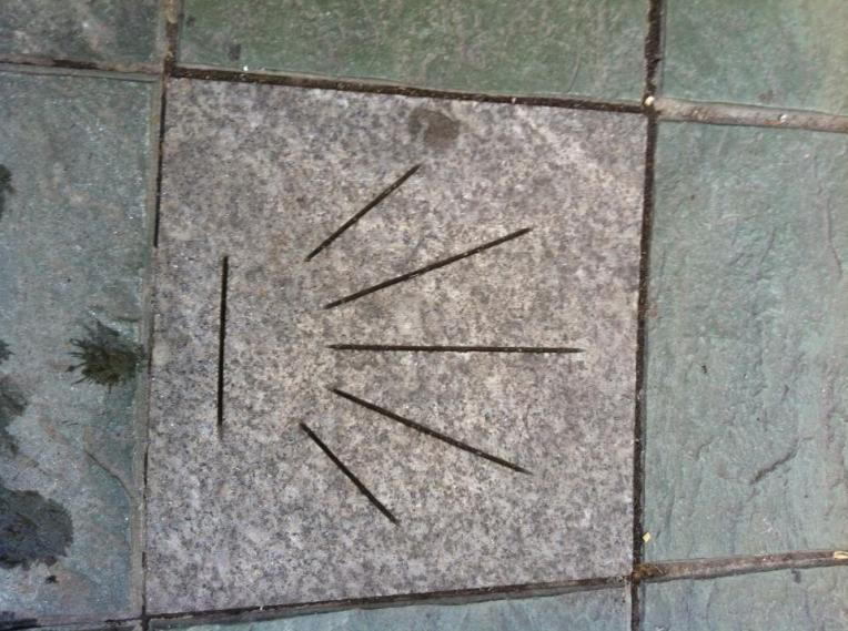 Camino markers in Sarria, where the lines start coming together is the direction you are to travel