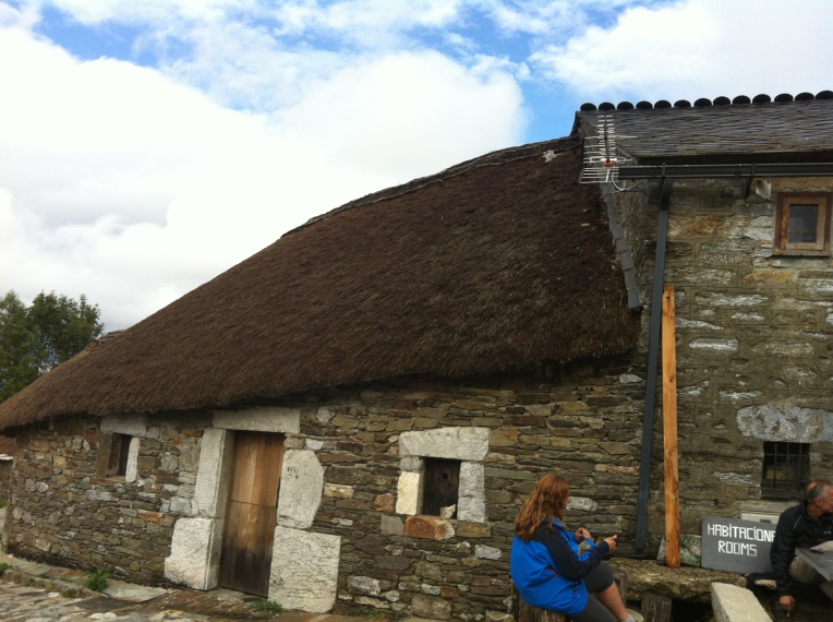 Tracy sitting at the restaurant, note the thatched roof of the owners attached home
