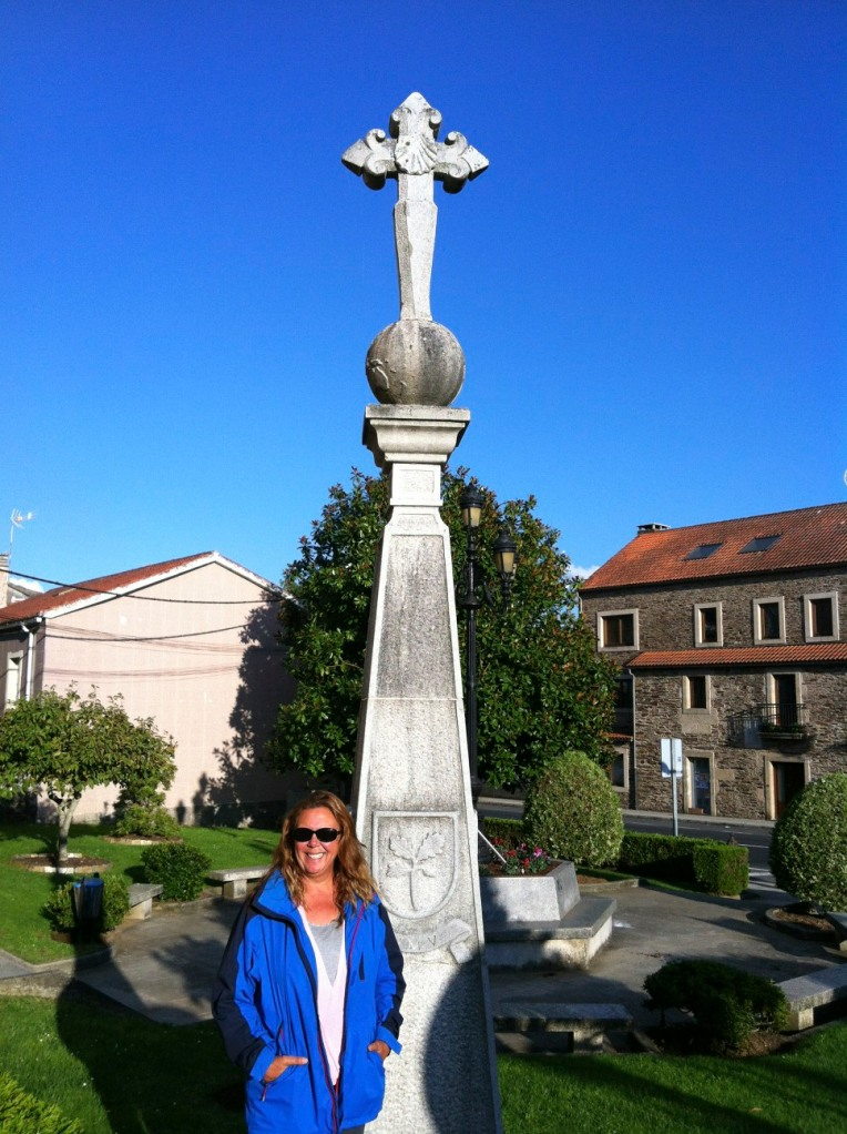 Tracy at monument with Cross of St. James in O Pedrouzo