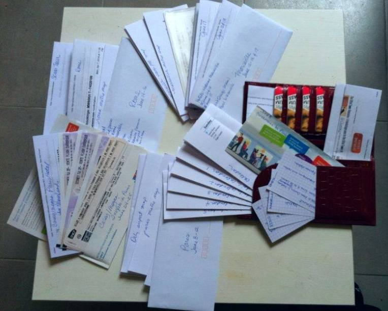 Tracy's collection of tickets, passes, reservations, and confirmations.