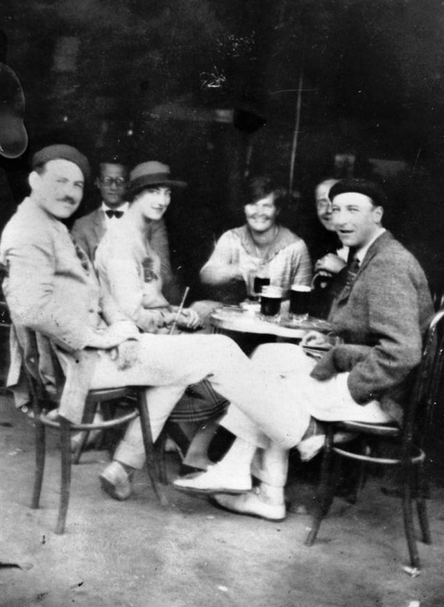"Ernest Hemingway seated in 1925 with the persons depicted in the novel ""The Sun Also Rises."" The individuals depicted include Hemingway, Harold Loeb, Lady Duff Twysden; and Hadley Richardson, Ogden Stewart and Pat Guthrie. John F. Kennedy Presidential Library and Museum, Boston"