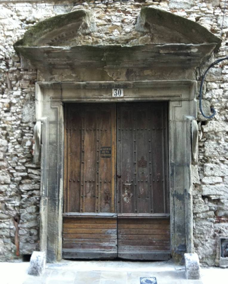 A striking antique door and frame on the Rue Coste Reboulh.