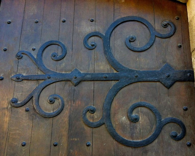 Detail of a hammered iron hinge on the front door of Cathédrale Saint-Michel de Carcassonne