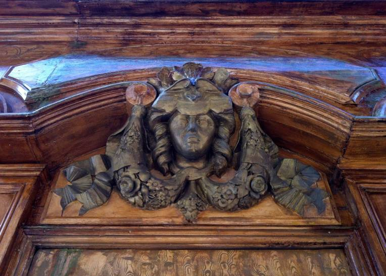 An ornamental carved lintel above a door on the Rue Coutejarie