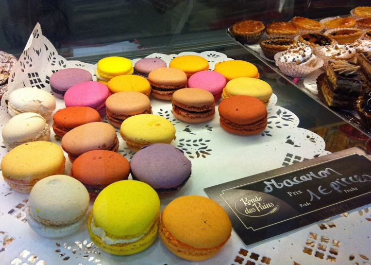 Macarons displayed  at a pâtisserie.