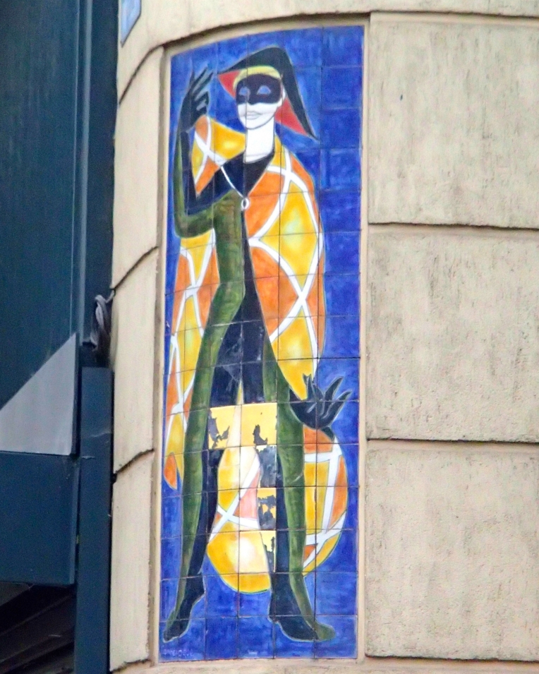 Harlequin wall tiles across from the Tourist Office on Rue de Verdun.