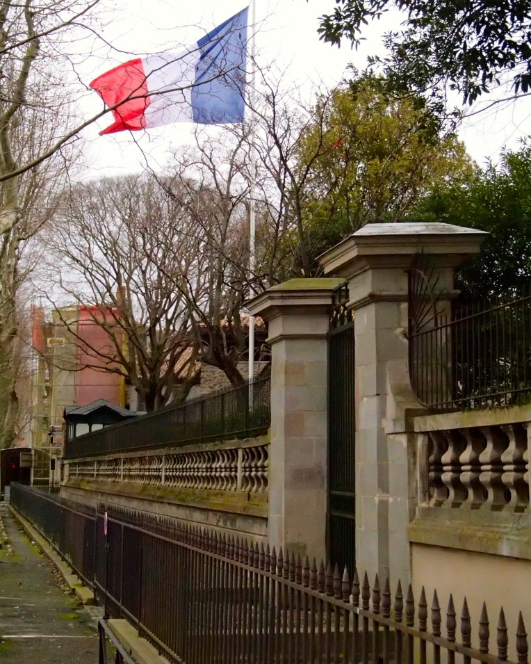 The French tricolor flying outside the Préfecture de l'Aude