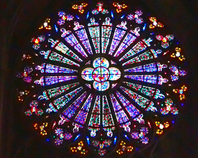 Rose window stained glass is Basilique Saint-Nazaire-et-Saint-Celse de Carcassonne (Basilica of St. Nazaire and St. Celse) within le Cité de Carcassonne.
