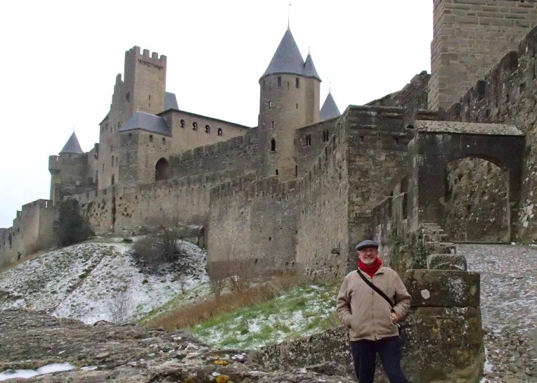 Alan standing near the Porte d'Aude (Aude Gate) entrance to le Cité de Carcassonne.
