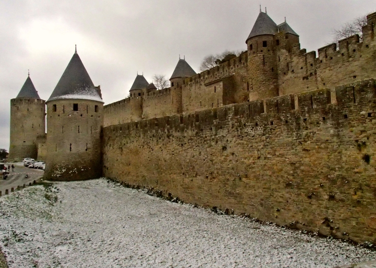 Light snow in the moat outside the walls of le Cité de Carcassonne.