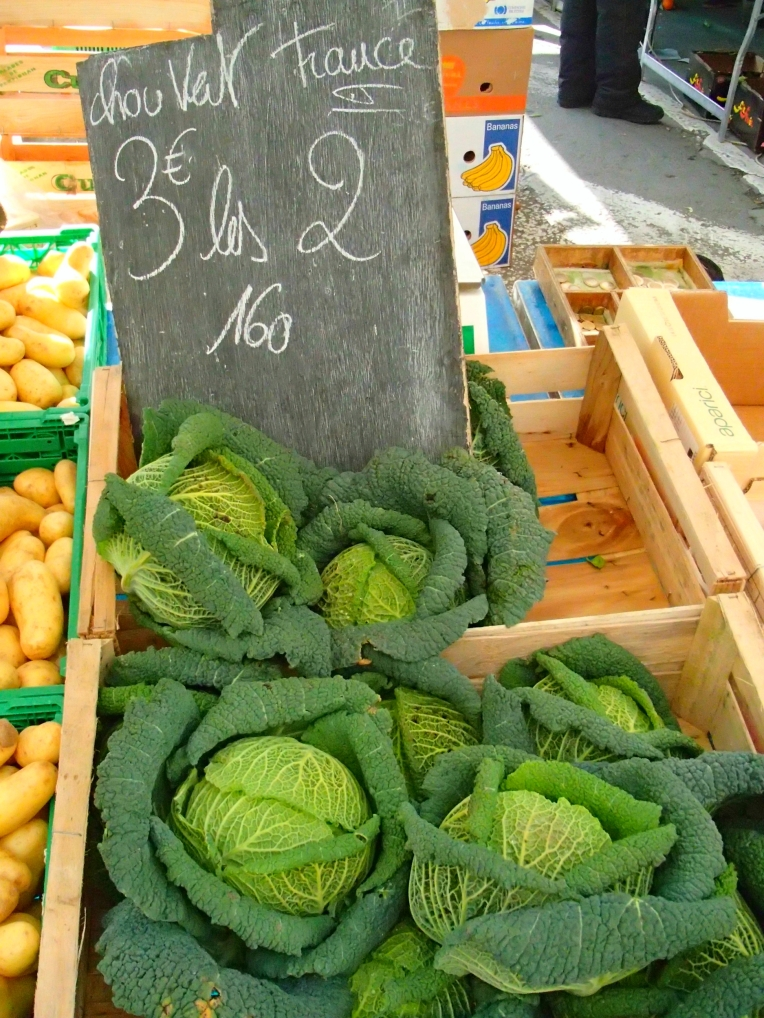 Chou vert (green cabbage) offered for sale in the open-air market in Place Carnot (the town square.)