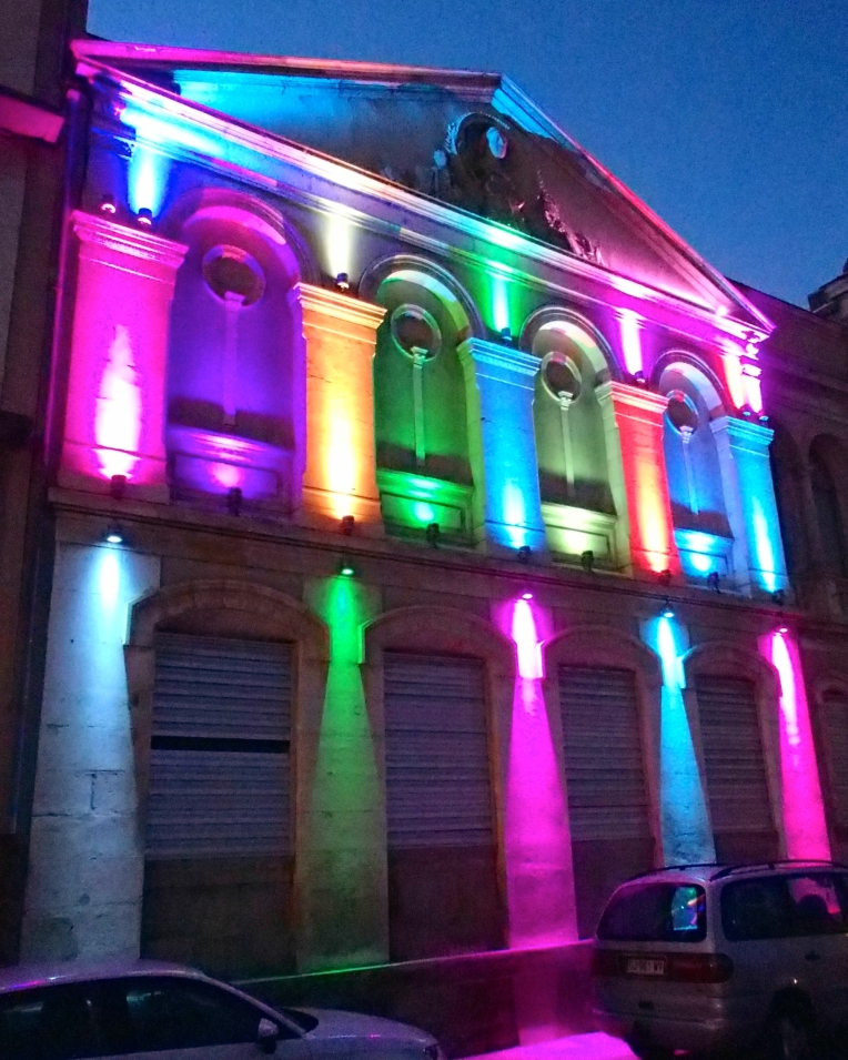 Multicolored lights illuminating the front of the Musée des Beaux-Arts (Museum of Fine Arts.)