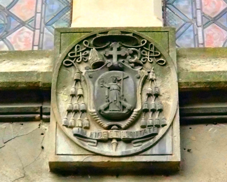 Ornamental lintel with the bishop's coat of arms above the entrance to the offices of the Diocèse de Carcassonne et Narbonne (Roman Catholic Diocese of Carcassonne and Narbonne).  The Diocese was established in 533.