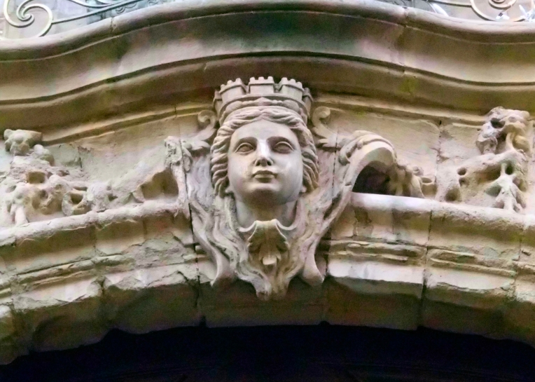 Ornamental lintel above the entrance to Hôtel de Rolland, an 18th century hôtel particulier which is now the Mairie (Town Hall)  on Rue Aimé Ramond