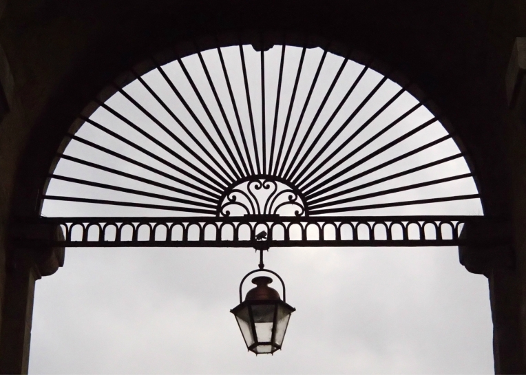 Ironwork and lamp at the top of the arch of the Porte des Jacobins à Carcassonne (Jacobin Gate).