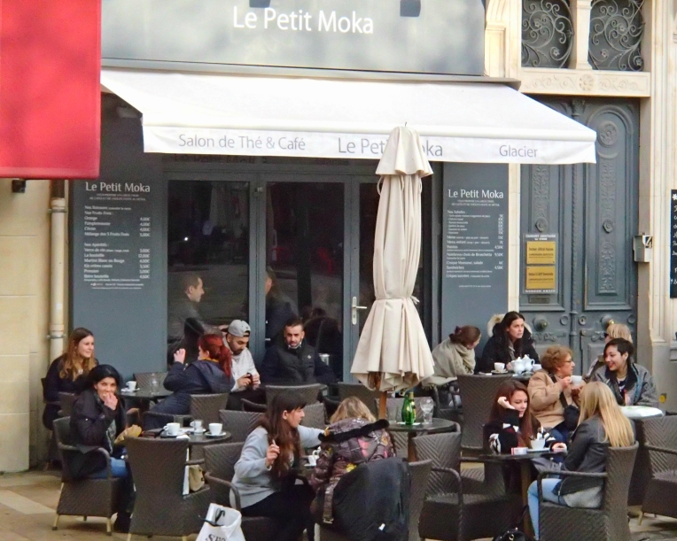 Patrons enjoying the day on the terrace outside Le Petit Moka in Place Carnot, the town square.