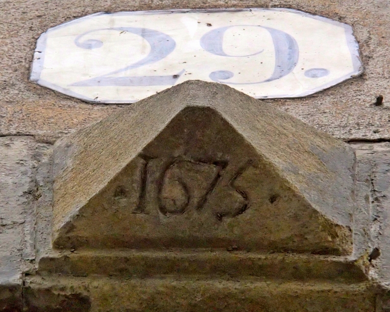 "A keystone with the date ""1675"" on a building neighboring our apartment on the Rue Du Pont Vieux"