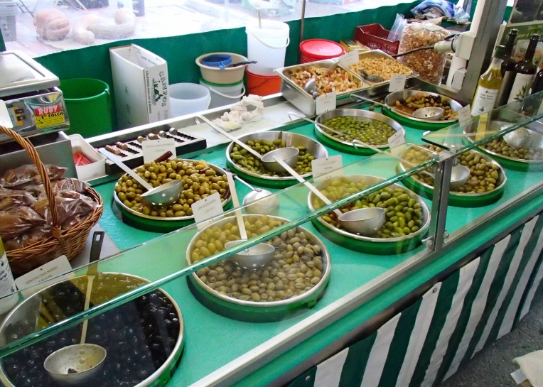 Olive bar at the open-air market in lace Carnot (town square.)