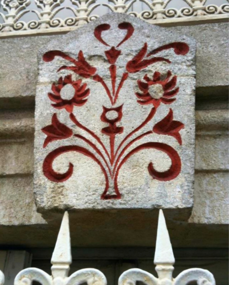 Decorative stonework above the windows of a residence on Boulevard Barbes.