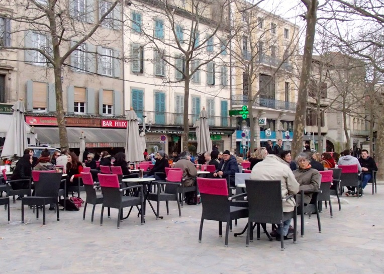 Patrons enjoying the cafes in Place Carnot (the town square.)