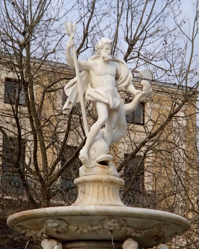 Statue of Neptune above the fountain in Place Carnot (the town square.)