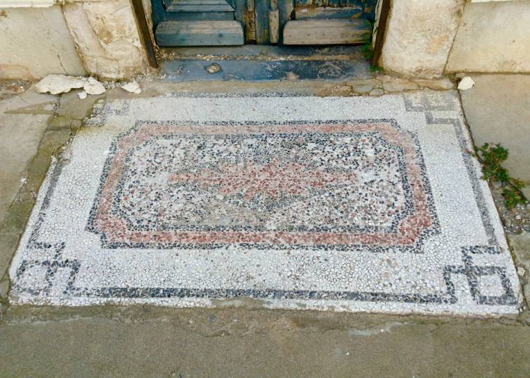 An old mosaic welcome mat.