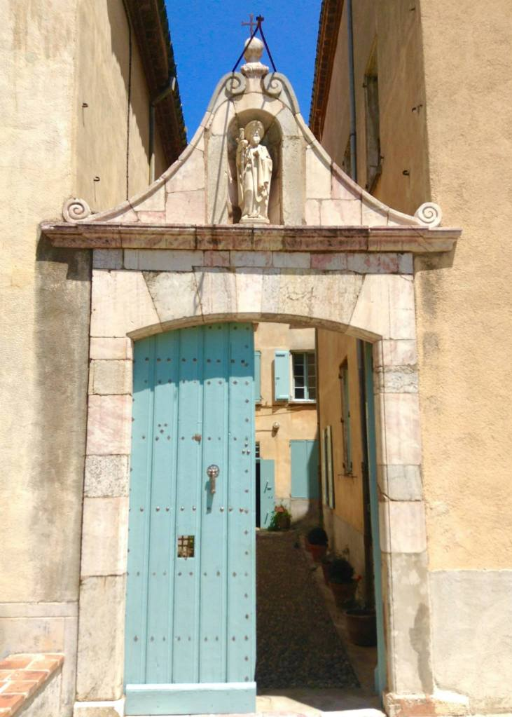 The gated entrance to the chapel and hospice with St. James watching from above.