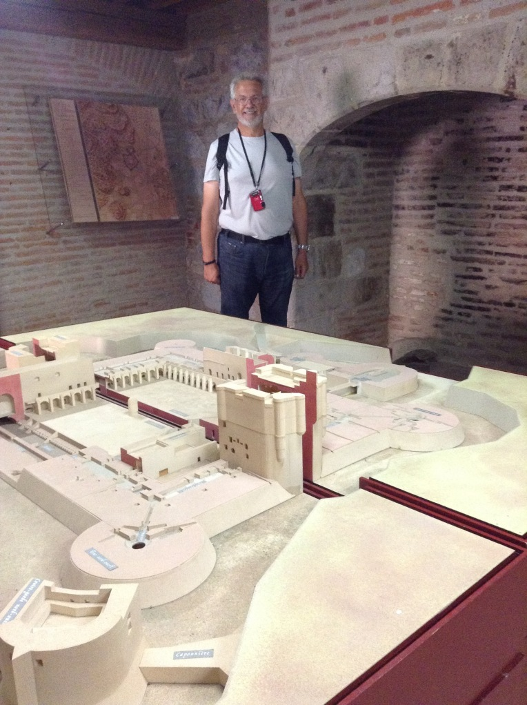Alan standing behind the model of the Forteresse de Salses in the museum.