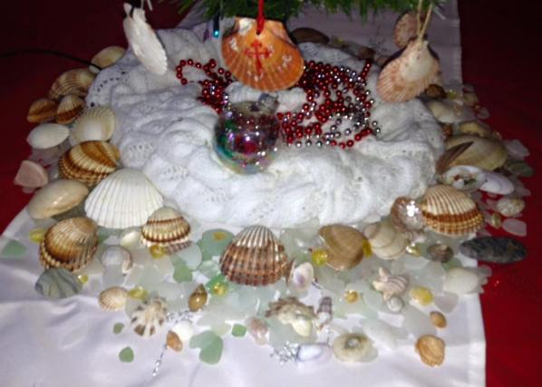 Base decor was sea shells and sea glass with a knit scarf for the tree skirt