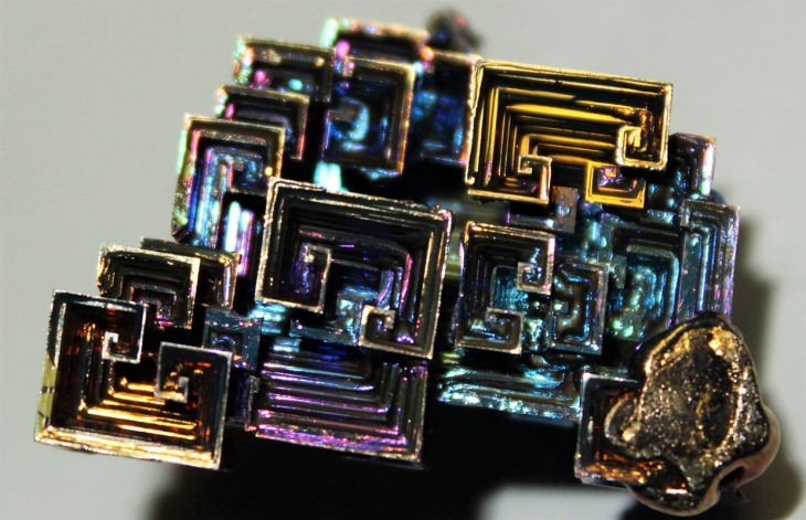 Bismuth crystal in gold, purple and blue