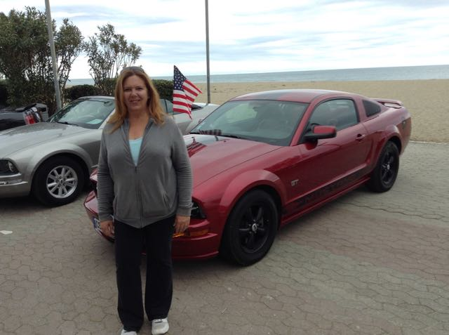 Tracy with one of the many Mustangs