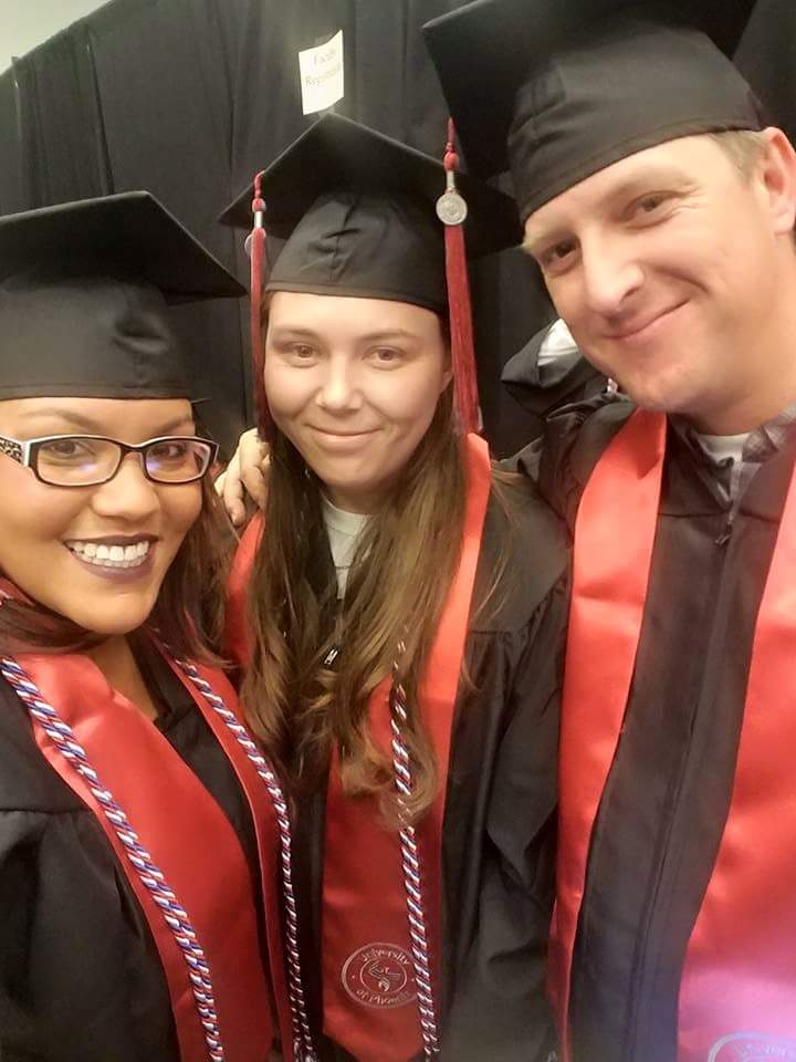 Dallas and fellow grads, Kayla and Ian