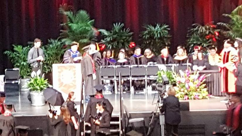 Dallas receiving her diploma