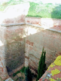 Large walls surround the fortress